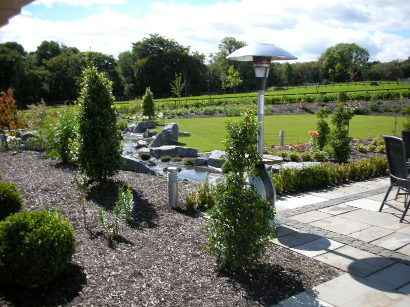 the garden design consisted of extensive stone detailing to tie with the style of the dwelling - Garden Design Kildare