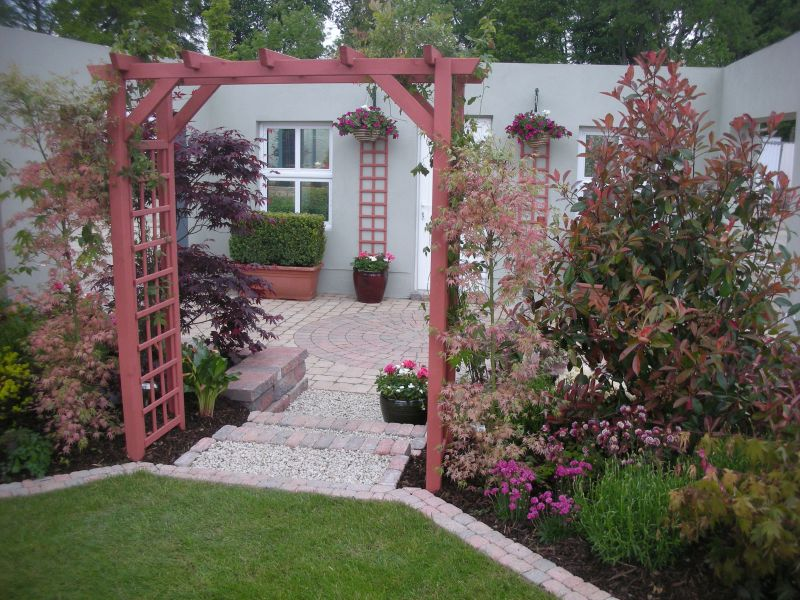 a warm burgundy wine colour theme is used throughout to give this garden design its distinct character award winning garden design from bloom 2013 - Garden Design Kildare